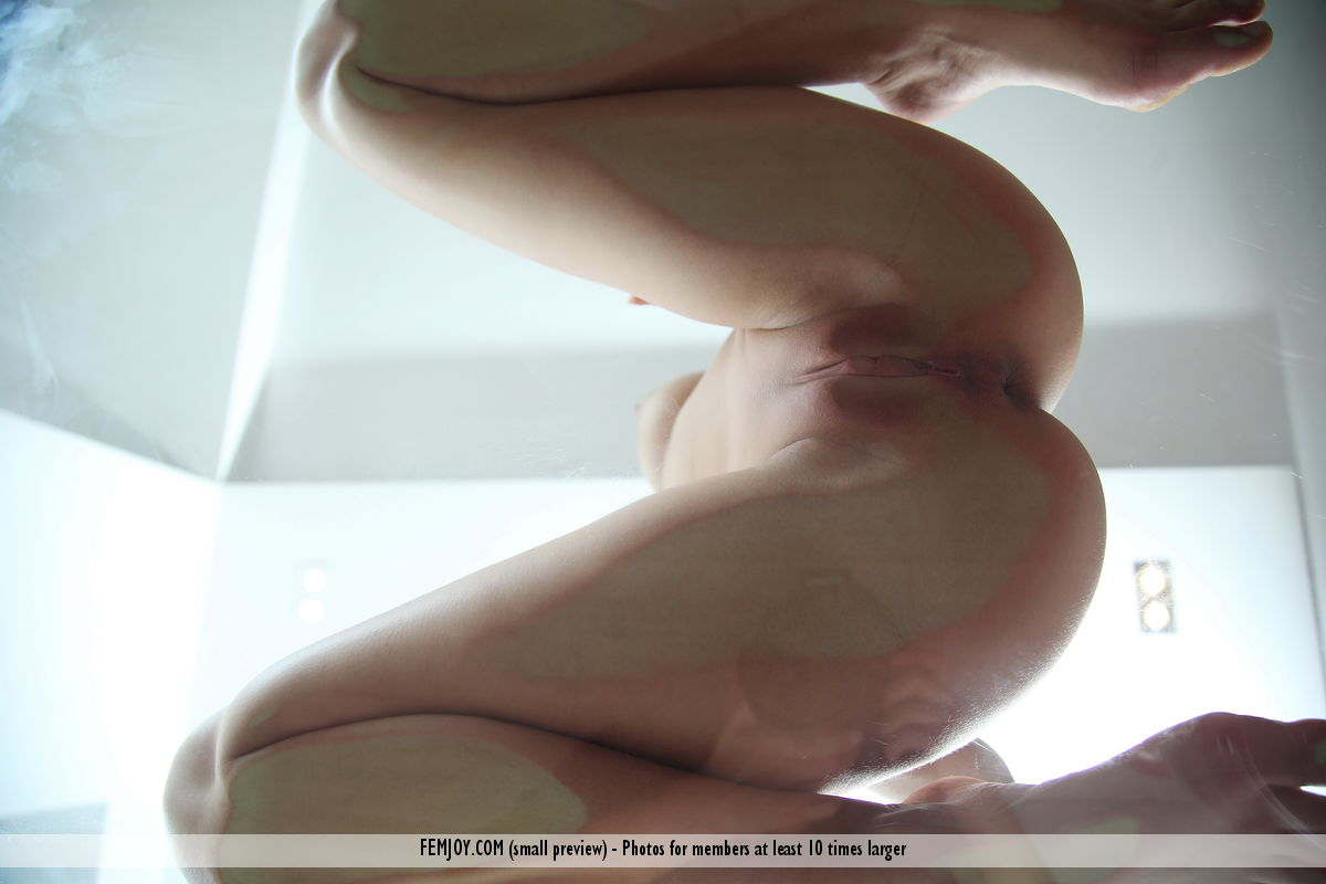 nudes sitting on glass